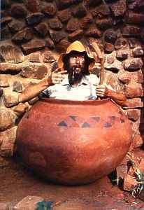 Egbert, demonstrating the size of a Tswana clay pot.