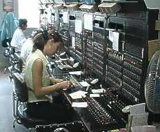 The friendly telephone exchange personnel busy helping us to get connected to the outside world.